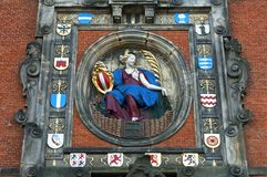 Colorful Virgin and coat of arms city gate Dordrecht. Netherlands, province South Holland, Dordrecht city: the land gate, gateway, the Groothoofdspoort in the stock images