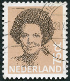 NETHERLANDS - 1981: shows Queen Beatrix, Black Vignette. NETHERLANDS - CIRCA 1981: A stamp printed in Netherlands shows Queen Beatrix, Black Vignette, circa 1981 Royalty Free Stock Photo