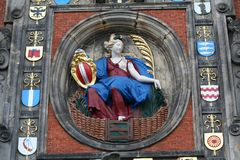 Relief on the Groothoofdspoort above the doorway facing the river. Netherlands,South Holland,Dordrecht , june 2016:  the Dordrecht maiden sitting in the garden Royalty Free Stock Photos