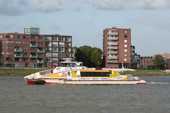 Water-bus and view on Papendrecht. Netherlands,South Holland,Dordrecht,june 2016: Water-bus and view on Papendrecht stock images