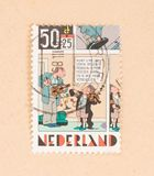 THE NETHERLANDS 1980: A stamp printed in the Netherlands shows a cartoon, circa 1980. A stamp printed in the Netherlands shows a cartoon, circa 1980 stock image
