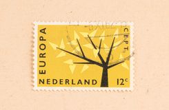 THE NETHERLANDS 1980: A stamp printed in the Netherlands shows holland as part of Europe, circa 1980. A stamp printed in the Netherlands shows holland as part of royalty free stock image