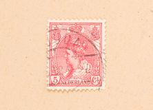 THE NETHERLANDS 1950: A stamp printed in the Netherlands shows the queen, circa 1950 stock image