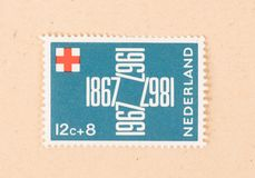 THE NETHERLANDS 1980: A stamp printed in the Netherlands shows the Red Cross in the Netherlands, circa 1980. A stamp printed in the Netherlands shows the Red stock photography