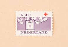 THE NETHERLANDS 1980: A stamp printed in the Netherlands shows the Red Cross in the Netherlands, circa 1980. A stamp printed in the Netherlands shows the Red royalty free stock image