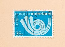 THE NETHERLANDS 1980: A stamp printed in the Netherlands shows holland as part of Europe, circa 1980. A stamp printed in the Netherlands shows holland as part of royalty free stock photos