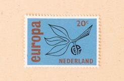 THE NETHERLANDS 1980: A stamp printed in the Netherlands shows holland as part of Europe, circa 1980. A stamp printed in the Netherlands shows holland as part of royalty free stock photography