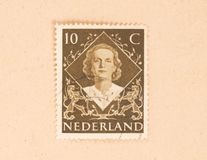 THE NETHERLANDS 1960: A stamp printed in the Netherlands shows the queen, circa 1960. A stamp printed in the Netherlands shows the queen, circa 1960 stock image