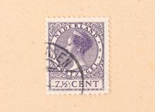 THE NETHERLANDS 1950: A stamp printed in the Netherlands shows the queen, circa 1950. A stamp printed in the Netherlands shows the queen, circa 1950 stock images