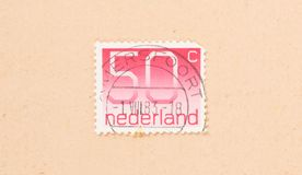 THE NETHERLANDS 1980: A stamp printed in the Netherlands shows it`s value of 50 cents, circa 1980. A stamp printed in the Netherlands shows it`s value of 50 royalty free stock photography