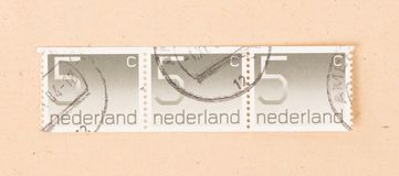 THE NETHERLANDS 1980: A stamp printed in the Netherlands shows it`s value of 5 cents, circa 1980. A stamp printed in the Netherlands shows it`s value of 5 cents stock photo