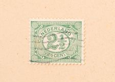 THE NETHERLANDS 1950: A stamp printed in the Netherlands shows it`s value, circa 1950. A stamp printed in the Netherlands shows it`s value, circa 1950 royalty free stock photos