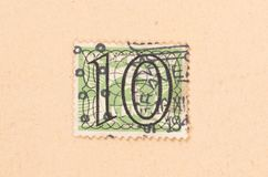 THE NETHERLANDS 1950: A stamp printed in the Netherlands shows it`s value, circa 1950. A stamp printed in the Netherlands shows it`s value, circa 1950 royalty free stock photography