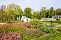 Garden with flowerbeds by castle Staverden. Royalty Free Stock Photography