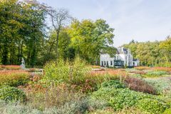 Garden with flowerbeds by castle Staverden. Stock Photo
