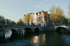 Netherlands traditional houses and Amsterdam canal in Amsterdam stock photography