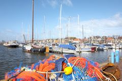 Docked boats in the port of Urk. NETHERLANDS - URK - MARCH 8, 2019: Docked boats in the port of Urk royalty free stock images