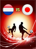 Netherlands versus Japan on Abstract Red Light Background Royalty Free Stock Images