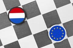 Netherlands vs European union. Draughts (Checkers) - Netherlands vs European union. Problem after referendum about association agreement between European union stock photo