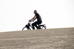 Solex-rider on the Brouwersdam, the seventh structure of the Delta Works. royalty free stock photos