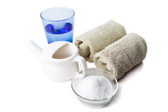 Neti Pot with water, salt and towels. A Neti pot - used for cleaning sinuses, as a prevention to flu, swine flu, colds or other viruses stock photography