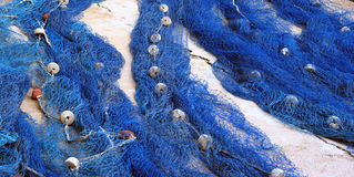 Nets. Blue fishing nets laid out to dry Stock Image