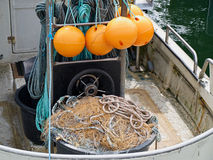 Nets and floats on a fishing boat Stock Photos