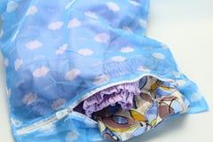 Nets laundry bag, for washing clothes in washing machine on white background. Stock Image