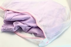 Nets laundry bag, for washing clothes in washing machine on white background. Stock Photo