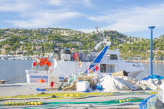Nets on pier. Fishing boat arrived in port - series. Royalty Free Stock Photo