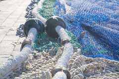 Nets on pier. Fishing boat arrived in port Stock Image