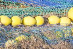 Nets on pier. Fishing boat arrived in portt. Nets on pier. Fishing boat arrived in port - series. Port d'Andratx, Mallorca, Balearic islands, Spain in October Royalty Free Stock Image