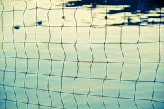 Nets and sea. Tensioned mesh with the ocean in the background Stock Image