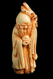 Netsuke 01. Netsuke (japan amulet) isolated on black Stock Image