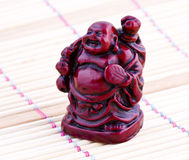 Netsuke. Red figure. Vintage statue.  Close up Royalty Free Stock Photo