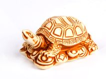 Netsuke. Turtle  figure isolated on white background. Close-up Royalty Free Stock Photos