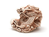 Netsuke of east dragon, which guarding the egg. Isolated. Netsuke of east dragon, which guarding the egg. A miniature sculpture, which was used as a button-like Stock Images
