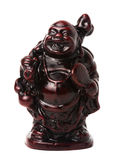 Netsuke happy fat man with a bag and a fan. Isolated. A miniature sculpture, which was used as a button-like trinket in traditional Japanese clothes kimono Stock Photos