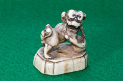 Netsuke - Ivory carving of Shishi. Antique Japanese ivory netsuke of shishi Royalty Free Stock Image