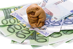 Netsuke rat and euro Royalty Free Stock Image