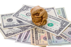 Netsuke rat and US dollar bills. Japanese Netsuke and US dollar bills.   Rat  - symbolizes wealth, prosperity and well-being Royalty Free Stock Photography