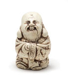 Netsuke of a satisfied man in a dressing gown. Isolated. A miniature sculpture, which was used as a button-like trinket in traditional Japanese clothes kimono Royalty Free Stock Photos