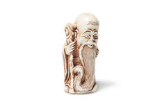 Netsuke. On a white backgroundn Stock Photography