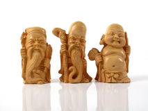 Netsukes. Three japanese netsuke charms on a white background Royalty Free Stock Images