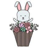 Nett wenig Kaninchen mit Korbstroh und -blumen stock abbildung