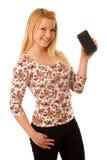 Nette blonde Frau mit dem Tablet-Computer lokalisiert über weißem backgr Lizenzfreie Stockfotos