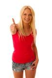 Nette blonde Frau mit dem Tablet-Computer lokalisiert über weißem backgr Lizenzfreies Stockfoto