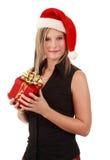 Nette Frau, die Sankt-Hut trägt Stockfoto