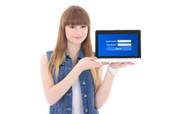 Nette Jugendliche, die Laptop mit Anmeldungsplatte auf Schirmisolator hält Lizenzfreies Stockbild