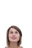 Nette junge Frau, die oben schaut Stockfoto